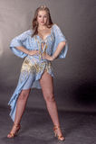 Portrait of a blonde dancing latino in a dance suit Royalty Free Stock Photos