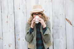 Portrait of blonde drinking from disposable cup Stock Images