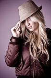 Portrait of blonde female holding hat Royalty Free Stock Image