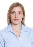 Portrait of a blonde german woman in blue blouse. On an isolated white background for cut out royalty free stock photo