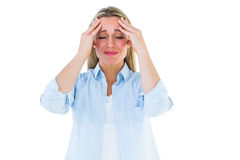 Portrait of a blonde getting a headache Stock Images
