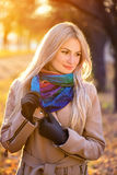 Portrait of blonde girl in autumn park royalty free stock photo