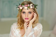 Portrait of a blonde girl with blue eyes with a wreath of flower. S on her head. Close-up, Beauty Royalty Free Stock Photos