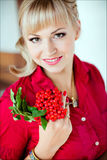 Portrait of a blonde girl with brown eyes in a red shirt , close Stock Image