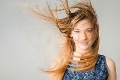 Portrait of  blonde girl with fluttering hair Royalty Free Stock Photo