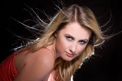 Portrait of blonde girl with flying hair. Studio shot royalty free stock image
