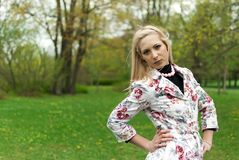 Portrait of blonde girl in the park Stock Photos