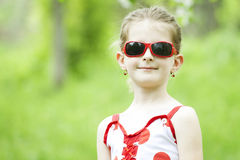 Portrait of blonde girl with red sunglasses Stock Image