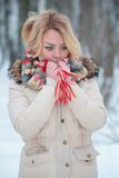 Portrait blonde girl red winter scarf stock photos