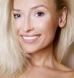 Portrait of blonde girl with toothy smile. Stock Image