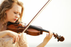 Portrait blonde girl with a violin outdoor Royalty Free Stock Images