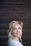 Portrait of blonde girl on a wooden wall background Royalty Free Stock Photography
