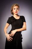 Portrait of a blonde girls in black dress Royalty Free Stock Photo