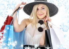 Portrait of blonde in hat with shopping bags Royalty Free Stock Photography
