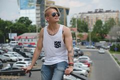Portrait blonde hipster boy with tattoos and stylish hair royalty free stock image