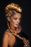 Portrait of blonde lady in creative hair. Stock Photography