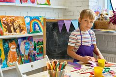 Little Boy Posing in Art Studio royalty free stock image