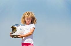 Portrait of blonde little girl in an astronaut costume dreaming of becoming a spacemen Royalty Free Stock Images
