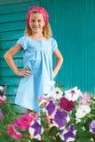 Portrait of blonde little girl standing in the garden  Stock Image