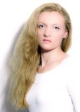 Portrait of a blonde with long hair. Royalty Free Stock Image