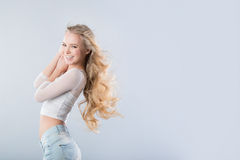 Portrait of the blonde with long wavy hair Royalty Free Stock Images