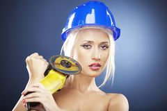 Portrait of a blonde model with angle grinder Royalty Free Stock Photo