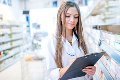 Portrait of blonde pharmacist or health care worker Stock Photo