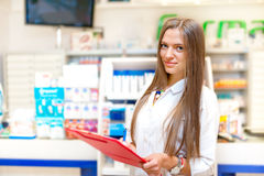 Portrait of blonde pharmacist or health care worker Stock Photos