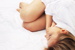 Portrait of a blonde sleeping in bed Stock Photos