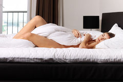 Portrait of a blonde sleeping in bed room Royalty Free Stock Photo
