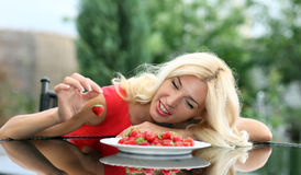 Portrait of a blonde strawberries Stock Images