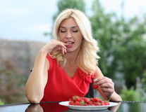 Portrait of a blonde strawberries Royalty Free Stock Image