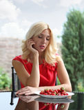 Portrait of a blonde strawberries Royalty Free Stock Photos