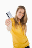 Portrait of a blonde student tending a credit card Stock Images