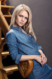 Portrait of a blonde in the Studio about stairs Royalty Free Stock Image