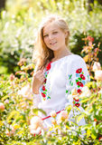 Portrait of blonde ukrainian girl in national clothes at meadow Royalty Free Stock Image