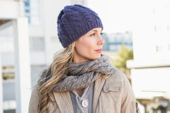 Portrait of blonde in warm clothes thinking Stock Image