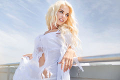 Portrait of the blonde wearing ragged dress Royalty Free Stock Photos