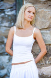 Portrait of a blonde in a white dress Royalty Free Stock Image