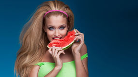 Portrait of blonde woman eating watermelon. Royalty Free Stock Photo