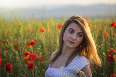 Portrait of blonde woman in field of poppies Stock Images