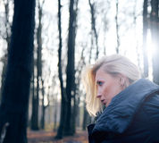 Portrait of blonde woman in forest. Royalty Free Stock Image