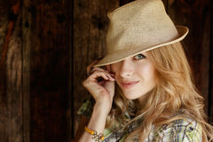 Portrait of Blonde Woman with Hat Stock Images