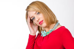 Portrait of a blonde woman with head pain wearing red dress Stock Photos