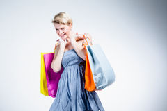 Portrait of a blonde woman holding bags Stock Photography