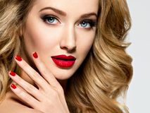Pretty woman with long  hair and red nails Royalty Free Stock Photos