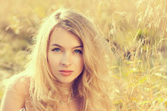 Portrait of Blonde Woman on Nature Background Royalty Free Stock Photo