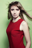 Portrait of the blonde woman in a red dress Royalty Free Stock Images