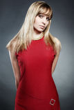 Portrait of the blonde woman in a red dress Stock Photo