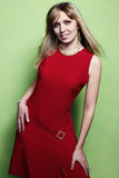 Portrait of the blonde woman in a red dress Stock Photography